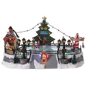 Ice rink Christmas village lights music 20x40x30 cm s1