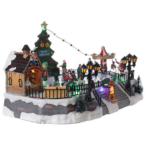 Ice rink Christmas village lights music 20x40x30 cm 4
