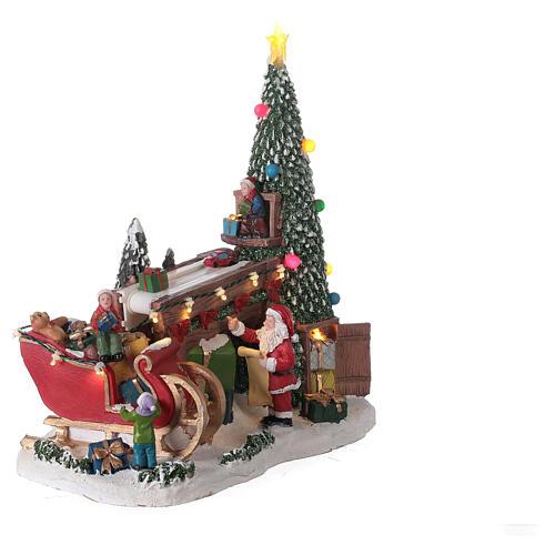 Villaggio natalizio fabbrica regali Babbo Natale luci musica 30x30x15 5