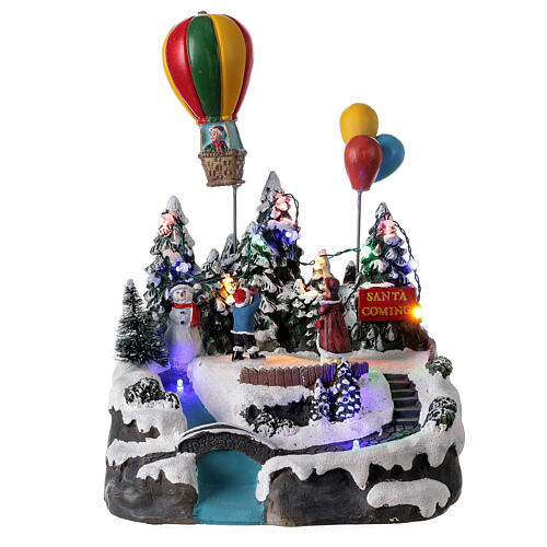 Village Noël enfants montgolfière lumières musique 25x20x20 cm 1