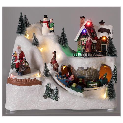 Villaggio natalizio treno slitta cavalli LED musica 20x25x15 cm 2