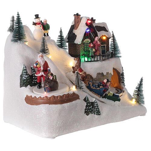Villaggio natalizio treno slitta cavalli LED musica 20x25x15 cm 3
