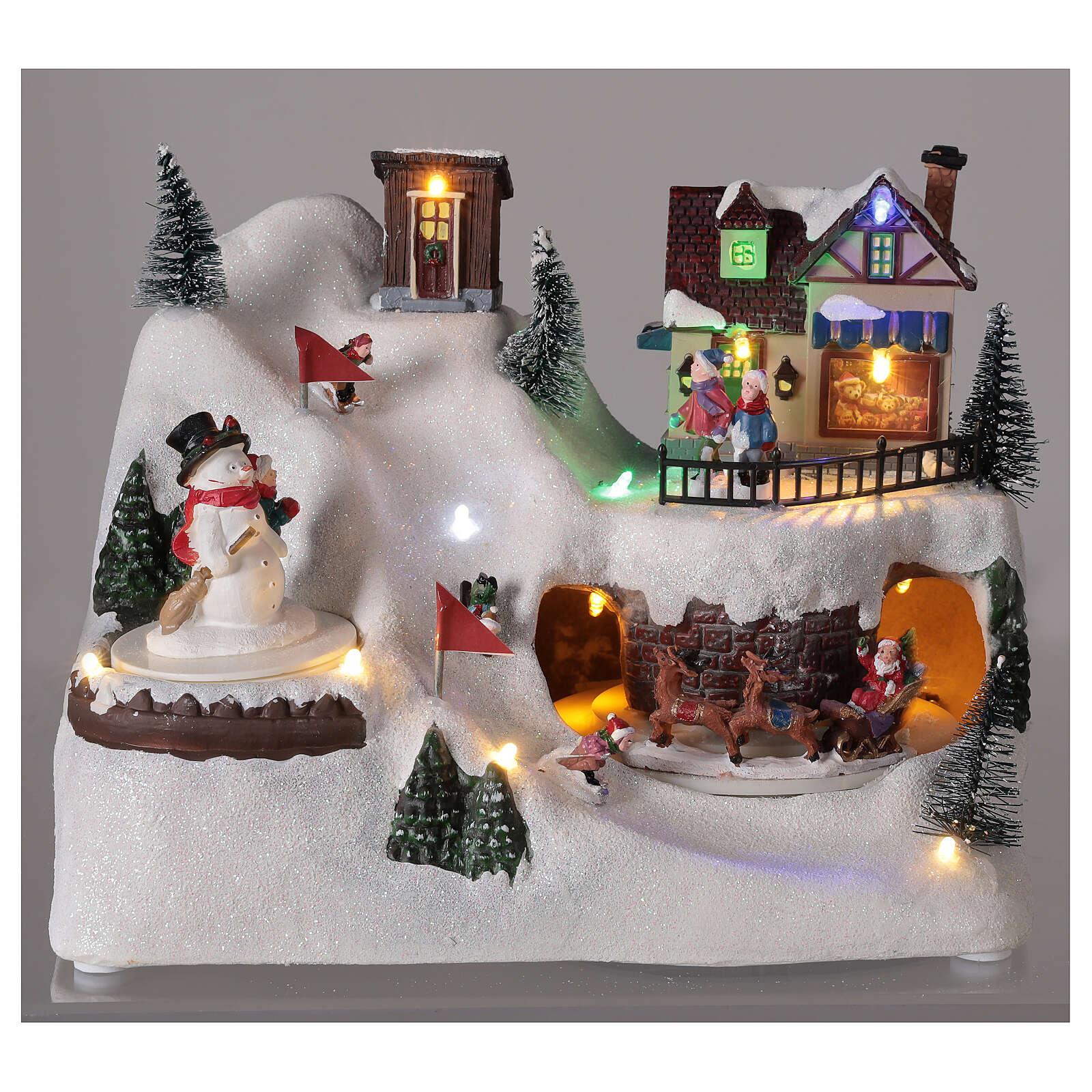 Village Noël skieurs mouvement musique lumières LED 20x25x15 cm 3
