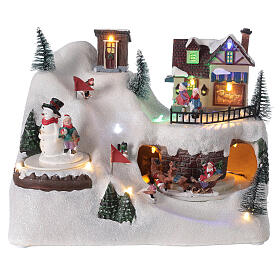 Village Noël skieurs mouvement musique lumières LED 20x25x15 cm s1