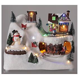 Village Noël skieurs mouvement musique lumières LED 20x25x15 cm s2