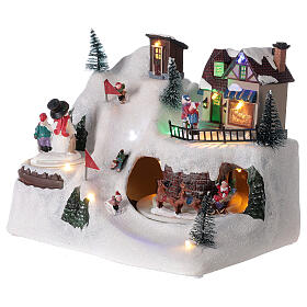 Village Noël skieurs mouvement musique lumières LED 20x25x15 cm s3