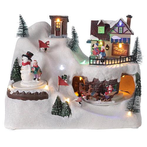 Village Noël skieurs mouvement musique lumières LED 20x25x15 cm 1