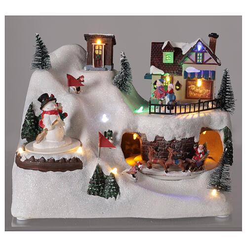 Village Noël skieurs mouvement musique lumières LED 20x25x15 cm 2