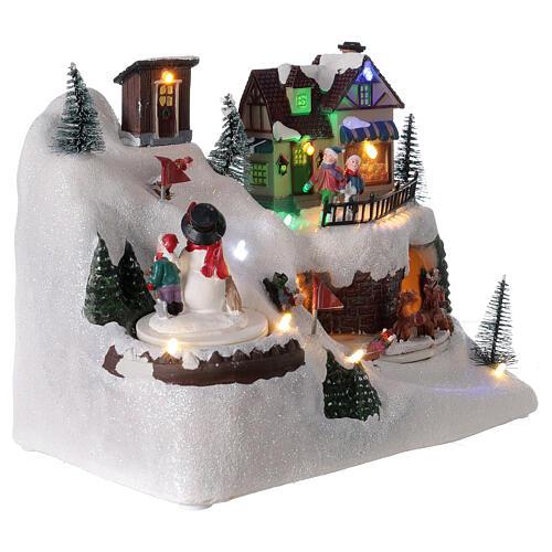 Village Noël skieurs mouvement musique lumières LED 20x25x15 cm 4