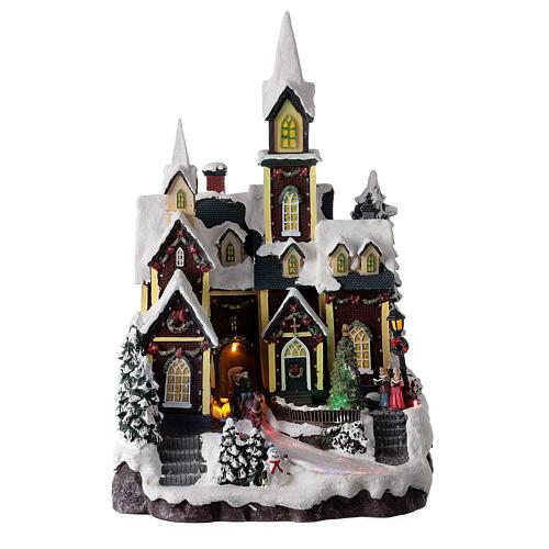 Chiesa nordica innevata villaggio Natale luci musica 45x30x25 cm 1