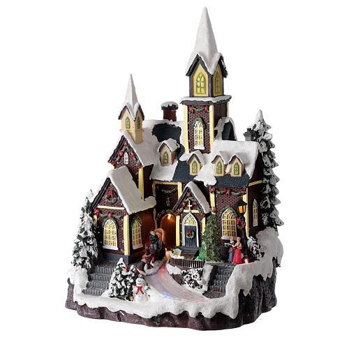 Chiesa nordica innevata villaggio Natale luci musica 45x30x25 cm 3