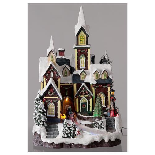 Igreja de estilo nórdico com neve, decoração natalina, luzes e música, 45x30x26 cm 2
