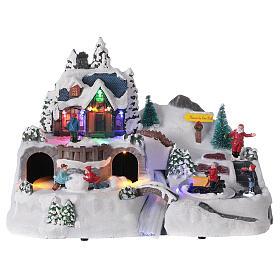 Aldeia de Natal nevada com crianças brincand na neve, luzes LED e música, 23,5x37,5x21,5 cm s7