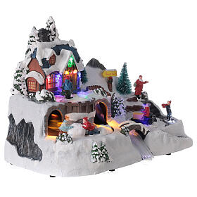 Aldeia de Natal nevada com crianças brincand na neve, luzes LED e música, 23,5x37,5x21,5 cm s10