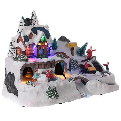 Aldeia de Natal nevada com crianças brincand na neve, luzes LED e música, 23,5x37,5x21,5 cm 4