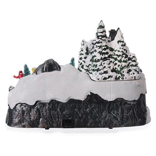 Aldeia de Natal nevada com crianças brincand na neve, luzes LED e música, 23,5x37,5x21,5 cm 5