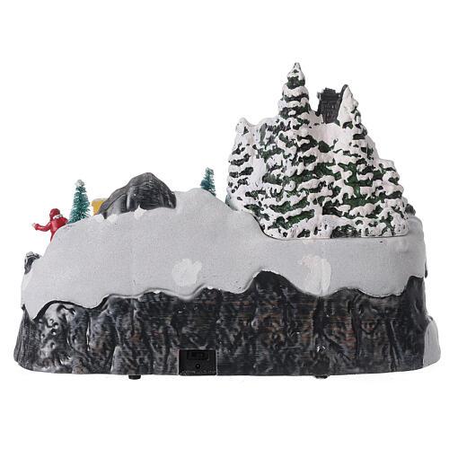 Aldeia de Natal nevada com crianças brincand na neve, luzes LED e música, 23,5x37,5x21,5 cm 11