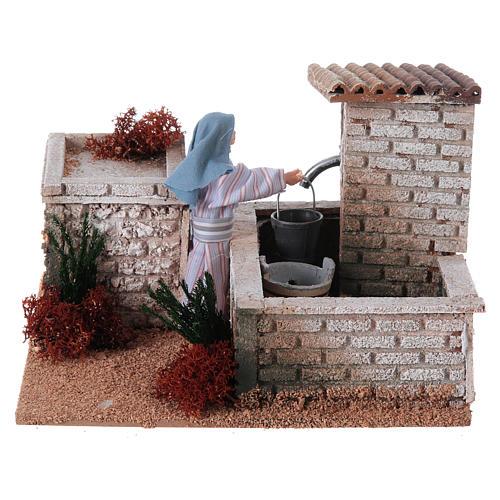 Kobieta przy fontannie szopka 12 cm ruchoma figurka 1