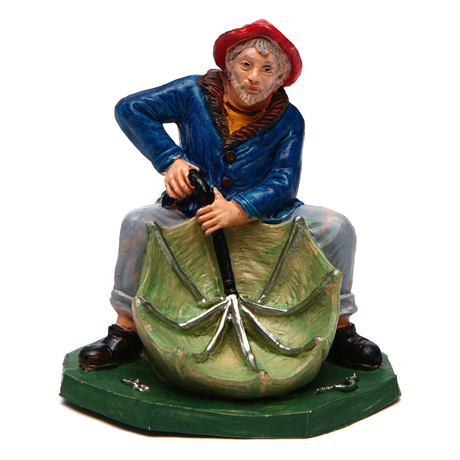 Hombre con paraguas verde de 10 cm de altura media belén 3