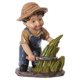 Estatua campesino con hoz belén línea niño 9 cm s1