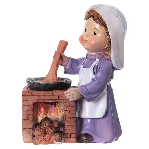 Statuina cuoca per presepe linea bambino di 9 cm 1