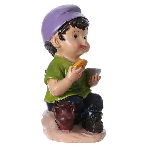 Estatua niño que come para belenes línea niño 9 cm 3