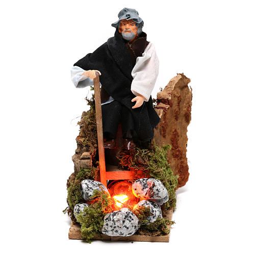 Shepherd at a fire with lights terracotta and plastic, 12 cm nativity 1