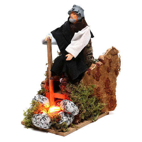 Shepherd at a fire with lights terracotta and plastic, 12 cm nativity 2