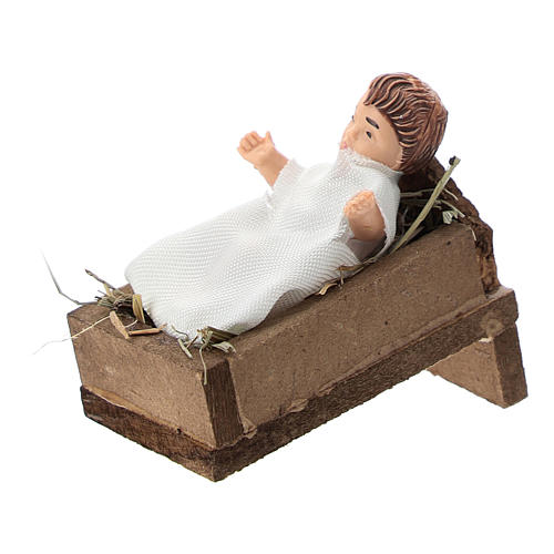 Statue of a baby with a cradle for Nativity scenes of 12 cm in terracotta and plastic 2
