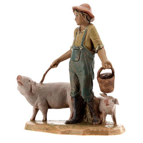 Joven con cerdos belén Fontanini 12 cm 2