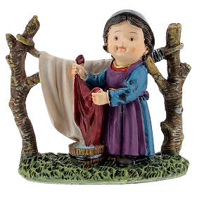 Woman hanging laundry kids nativity line 9 cm s1