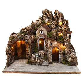 Illuminated nativity scene with cave and small houses 55X60X60 cm wood and cork s1