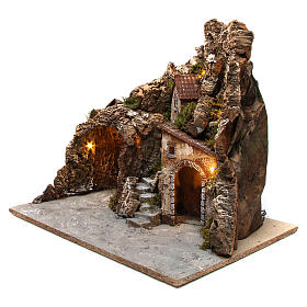 Illuminated nativity scene with cave and small houses 55X60X60 cm wood and cork s2