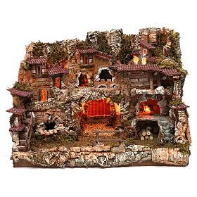 Pueblo con fuente y fuego 35x50x35 cm s1