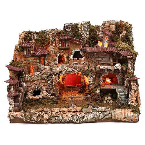 Pueblo con fuente y fuego 35x50x35 cm 1