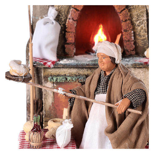 Oven with flickering light and baker Nativity scene 15 cm 2