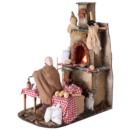 Oven with flickering light and baker Nativity scene 15 cm 3
