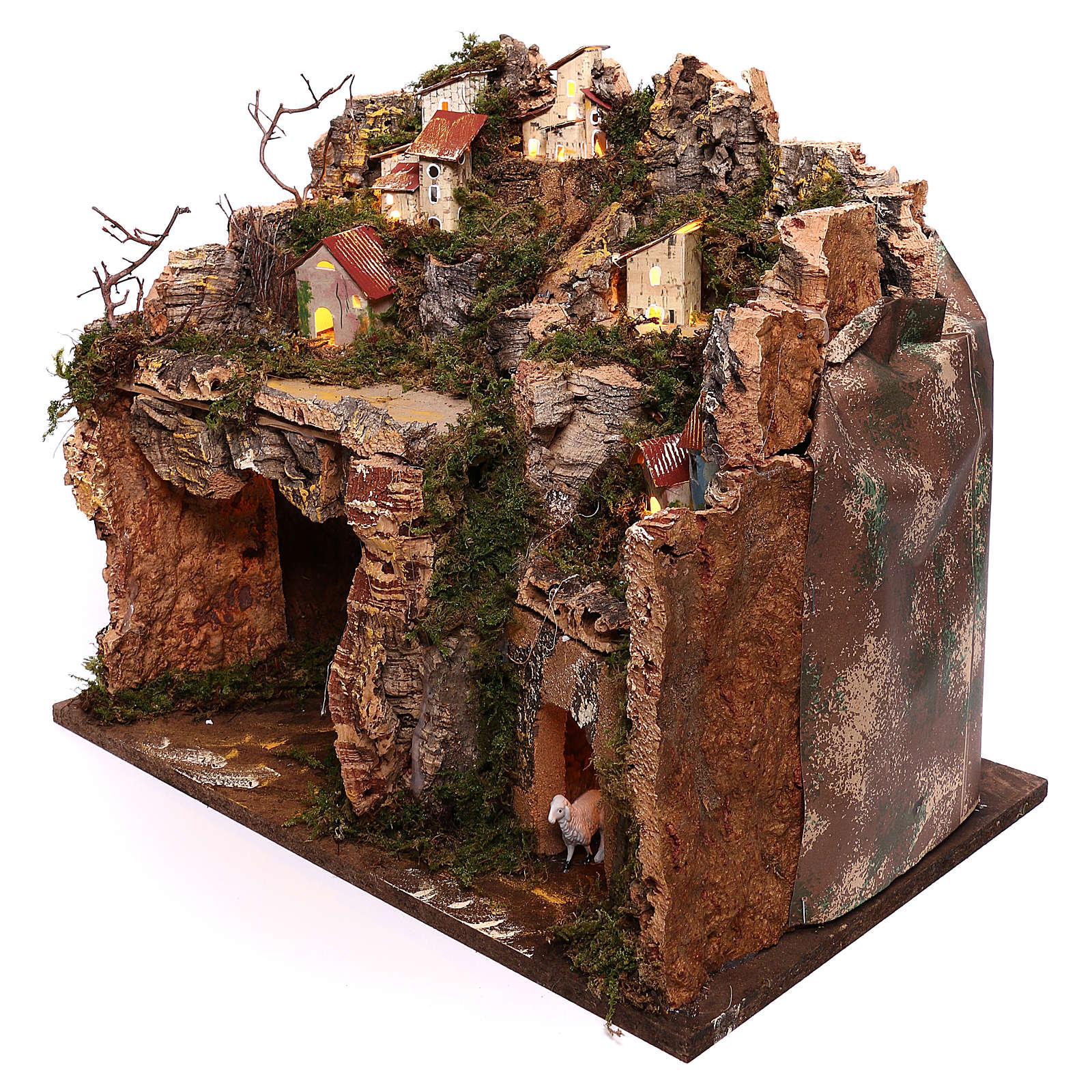 Borgo illuminato su montagna con grotta e fienile presepe 9 cm 4