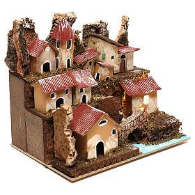 Petit village éclairé avec escalier et pont crèche 4 cm s3