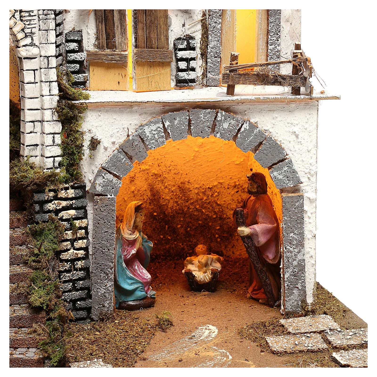 Pueblo iluminado con Natividad 10 cm 4