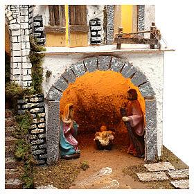 Pueblo iluminado con Natividad 10 cm s2