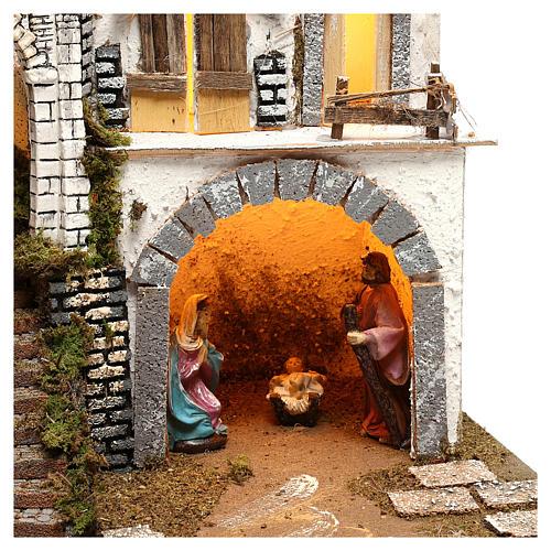 Pueblo iluminado con Natividad 10 cm 2
