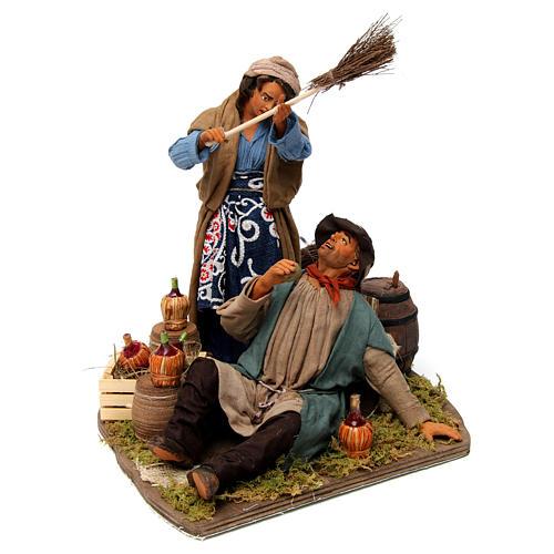 Moving woman beating her drunken husband Neapolitan Nativity Scene 30 cm 1