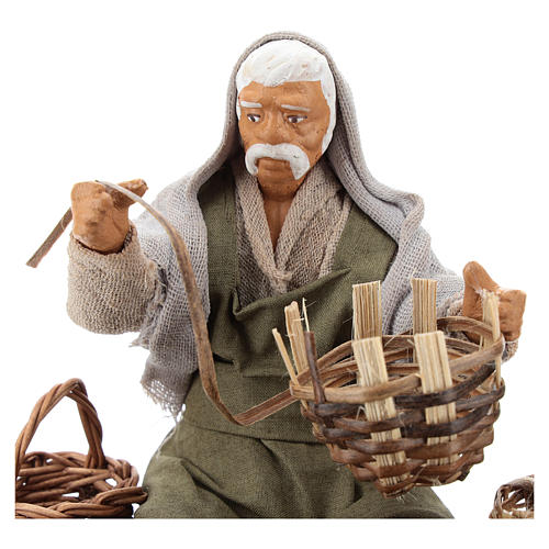 Seated basket repairer in resin Nativity scenes 14 cm 2
