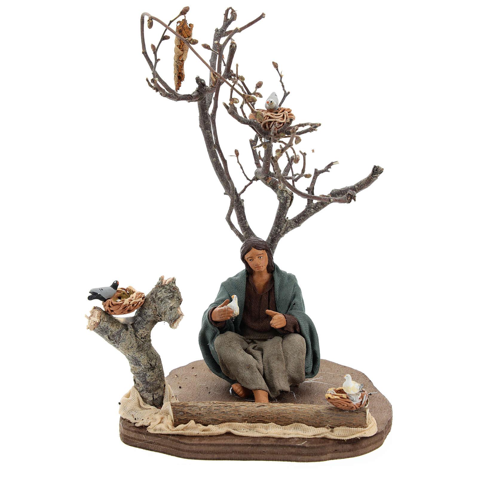 Femme assise sous un arbre avec oiseaux crèche 14 cm 4