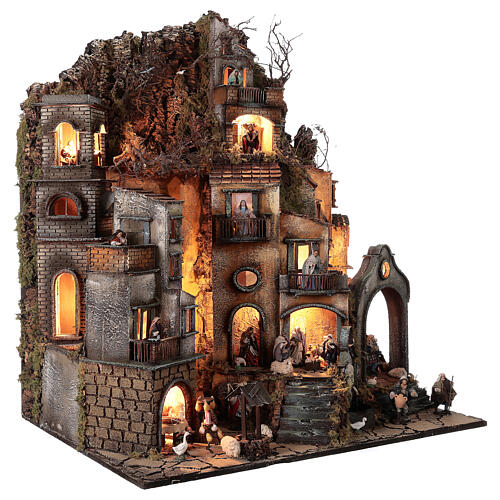 Neapolitan nativity village with bell tower church with animated figurines 8-10 cm 90x80x60 cm 5