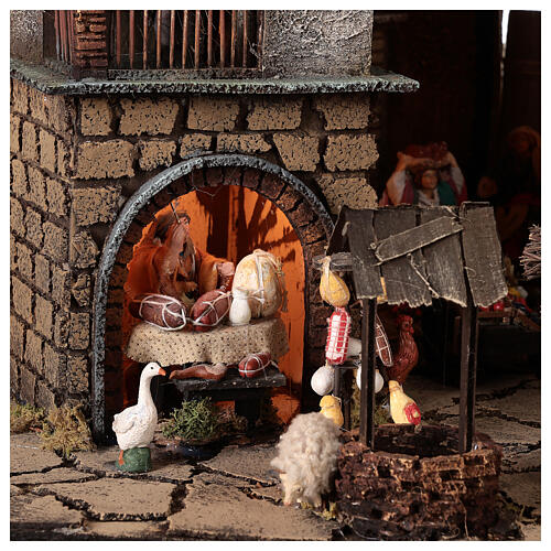 Neapolitan nativity village with bell tower church with animated figurines 8-10 cm 90x80x60 cm 8