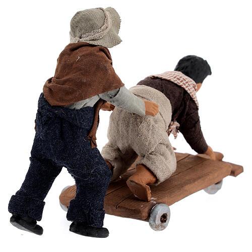 Crianças jogando com carrinho cena para presépio napolitano com figuras de altura média 13 cm 6