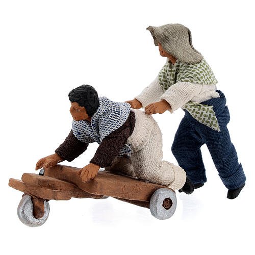 Pair of children playing with cart Neapolitan nativity 10 cm 1