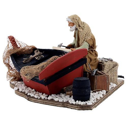 Homme qui répare son bateau mouvement Naples 14 cm 3
